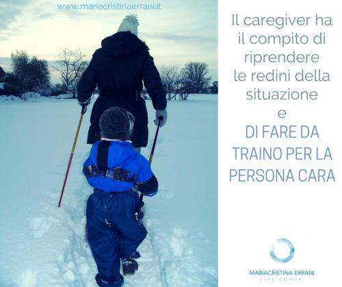 Mamma traina bambina in mezzo alla neve con frase: il caregiver ha il compito di riprendere le redini e di fare da traino per la persona cara